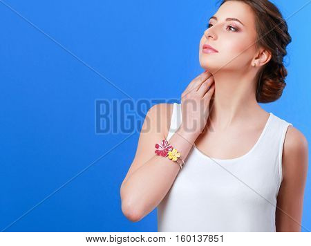 Beautiful casual young woman standing isolated against blue background.