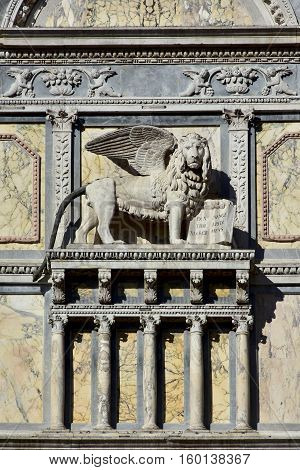 Saint Mark winged lion relief on renaissance facade in Venice designed by artist Pietro Lombardi in the 15th century