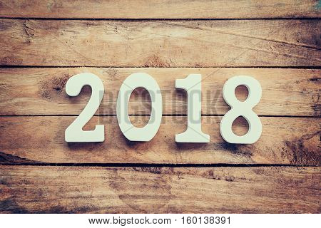 Wooden numbers forming the number 2018 For the new year 2018 on a rustic wooden background.