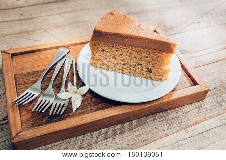 Close Up Coffee Cake On Wooden Table Background