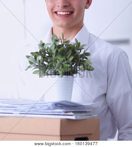 portrait of a person with moving box and other stuff