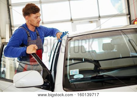 Man worker polishing car on a car wash.
