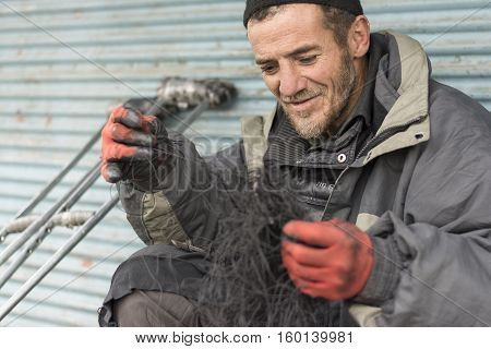 Tehran Province- IRAN-December 1 2016 A Portrait of Shoe Repairer Man at Tehran Urban Area
