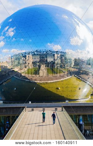 Paris France - October 15 2016: La Geode in the Parc de la Villette with unidentified people. Its a mirror-finished geodesic dome with an Omnimax theatre at the Cite des Sciences et de l Industrie