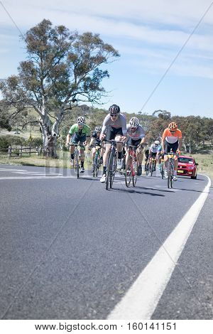 Jindabyne, Snowy Mountains Region, Australia - December 3, 2016: The first L'Etape cycling event held in Australia (by Le Tour de France).  The third breakaway group, all wanting to start the last stage in prime position.