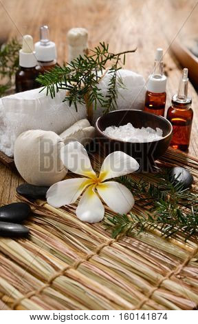 Spa treatment with Christmas decorations -mat and old wooden background