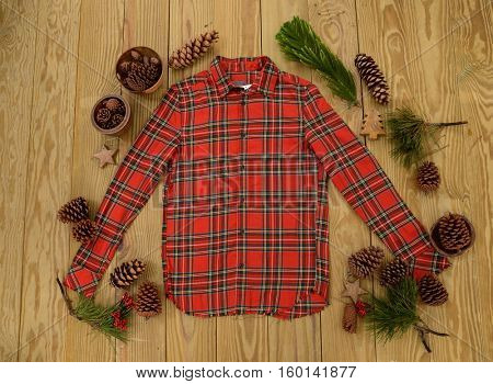 Fir tree with christmas decorations with clothes on the wooden background