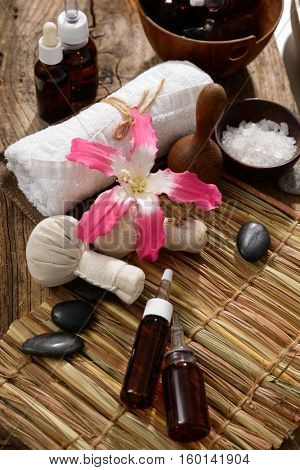 Composition of bath spa treatment on mat with wooden background