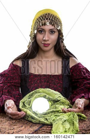 Female psychic or fortune teller with a crystal ball on a white background