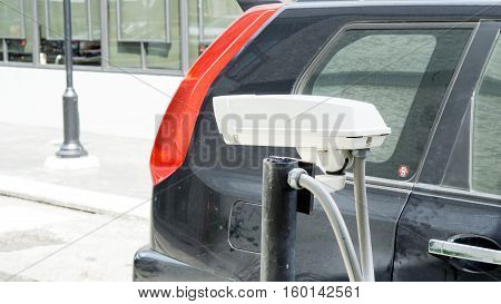 Security equipment concept - CCTV camera surveillance on car parking Safety system area control with black car and copy space