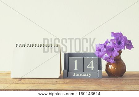 Vintage Wood Calendar For January Day 14 On Wood Table With Empty Note Book Space For Text.