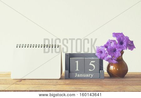 Vintage Wood Calendar For January Day 15 On Wood Table With Empty Note Book Space For Text.