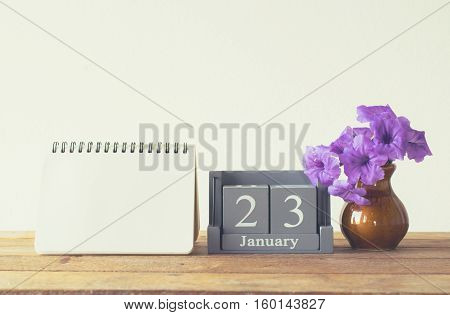 Vintage Wood Calendar For January Day 23 On Wood Table With Empty Note Book Space For Text.