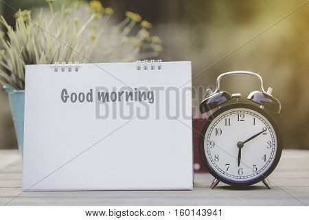 old-styled clock and Good morning note on the table