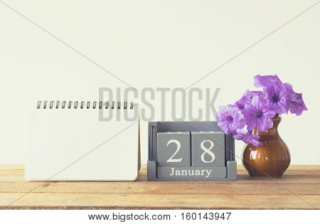 Vintage Wood Calendar For January Day 28 On Wood Table With Empty Note Book Space For Text.