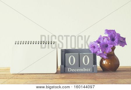 Vintage Wood Calendar For January Day 00 On Wood Table With Empty Note Book Space For Text.
