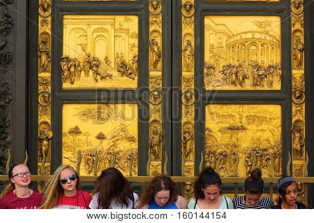 People In Front Of The Baptistery Portal In Florence, Italy
