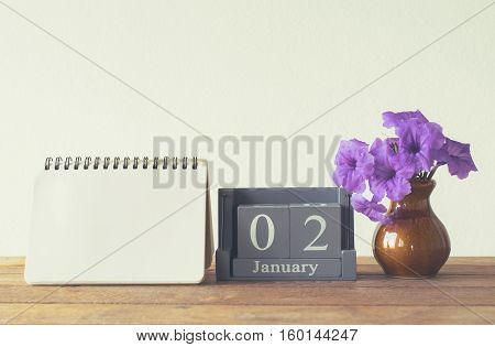 Vintage Wood Calendar For January Day 2 On Wood Table With Empty Note Book Space For Text.