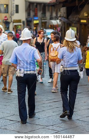 Policeman And Woman On The Ponte Vecchio In Florence, Italy