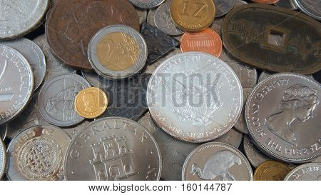 Close up of Coins from different countries of the world, old, silver, gold, nickel coins and silver dollar - Money background