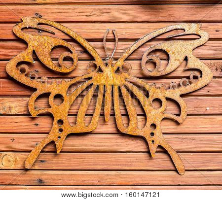 Metal butterfly and Wooden texture and background.
