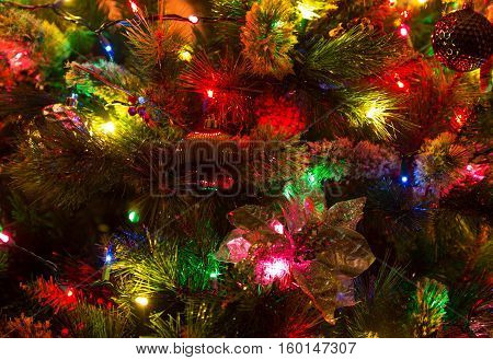 Close up of glowing lights and decorations on a Christmas tree