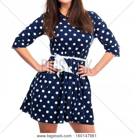Woman in a dress with polka dot print, isolated on white background