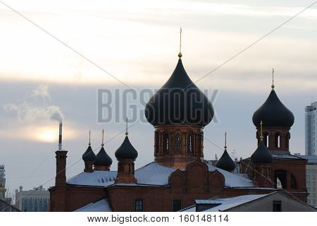 KAZAN, RUSSIA, 19 NOVEMBER 2016, ortodox Old believers ' Church on peterburgskaya stree in winter cold day with smoke frome tube, horizontal