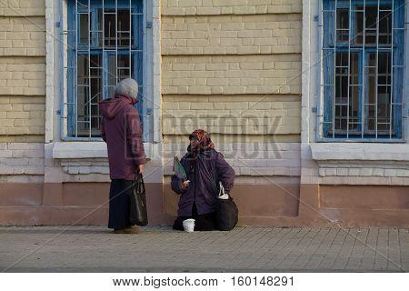 KAZAN, RUSSIA, 19 NOVEMBER 2016, A homeless female beggar is begging on the baumana street near orthodox church, horizontal