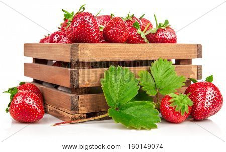 Fresh berries strawberry in wooden box with green leaf harvest fruits. Isolated on white background