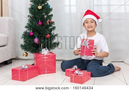 Asian Chinese Little Boy Holding Christmas Gift Box