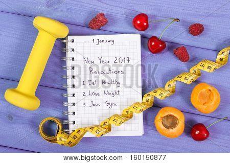 New Year Resolutions Written In Notebook On Purple Board
