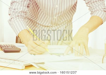 Businessman analyze the charts and graphs showing the results startup success concept