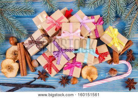 Wrapped Gifts With Ribbons For Christmas, Spices And Spruce Branches