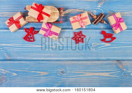 Wooden Sled And Wrapped Gifts With Ribbons For Christmas Or Other Celebration, Copy Space For Text