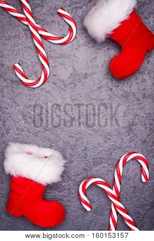 Christmas greeting card. Noel festive background. New year symbol. Santas shoes.