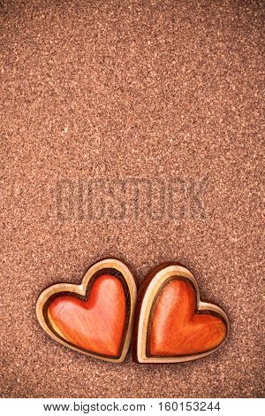 Two wooden hearts on rustic wood background. Valentines days concept.  Love symbol. Greeting card with copy space.
