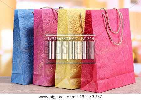 Barcode on shopping bags background. Wholesale and retail concept.