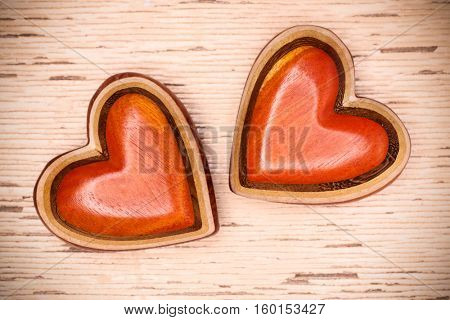 Two wooden hearts on rustic wood background. Valentines days concept.  Love symbol. Greeting card.