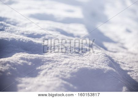Close view of shiny snowdrift in winter