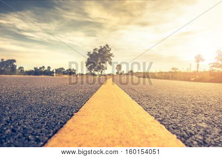 close up asphalt road highways road in rural scene vintage hipster road trip landscape.