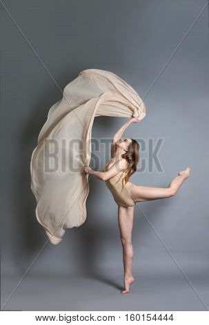 Beautiful Young Girl Dancing With Brightly Colored Fabrics.