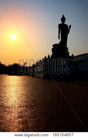 beautiful landscape silhouette buddha statue sacred with sunset on blue sky at phutthamonthon in Thailand