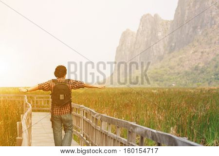 beautiful landscape with freedom people or tourist happy relax on vintage wood bridge in lotus plant lake at Khao Sam Roi Yod National Park in Thailand on winter or summer