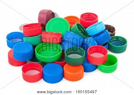 Plastic bottle caps on white background