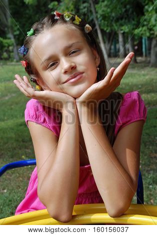 mischievous girl in dress posing on the playground