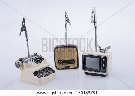 Retro Syled Tiny Television, Radio And Typewriter Model On White Background