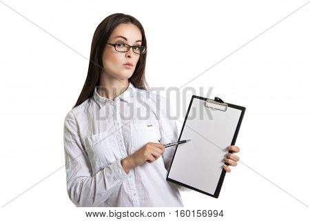 Young Beautiful Woman With A Clipboard In His Hands. Long-haired Brunette In Glasses And A White Shi