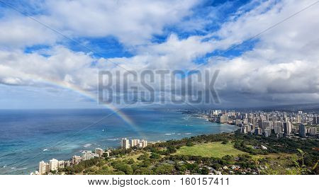 Beautiful rainbow appearing over Hawaii city skyline