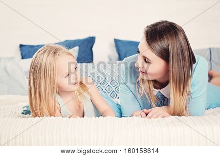 Mother and daughter looking at each other. Happy family